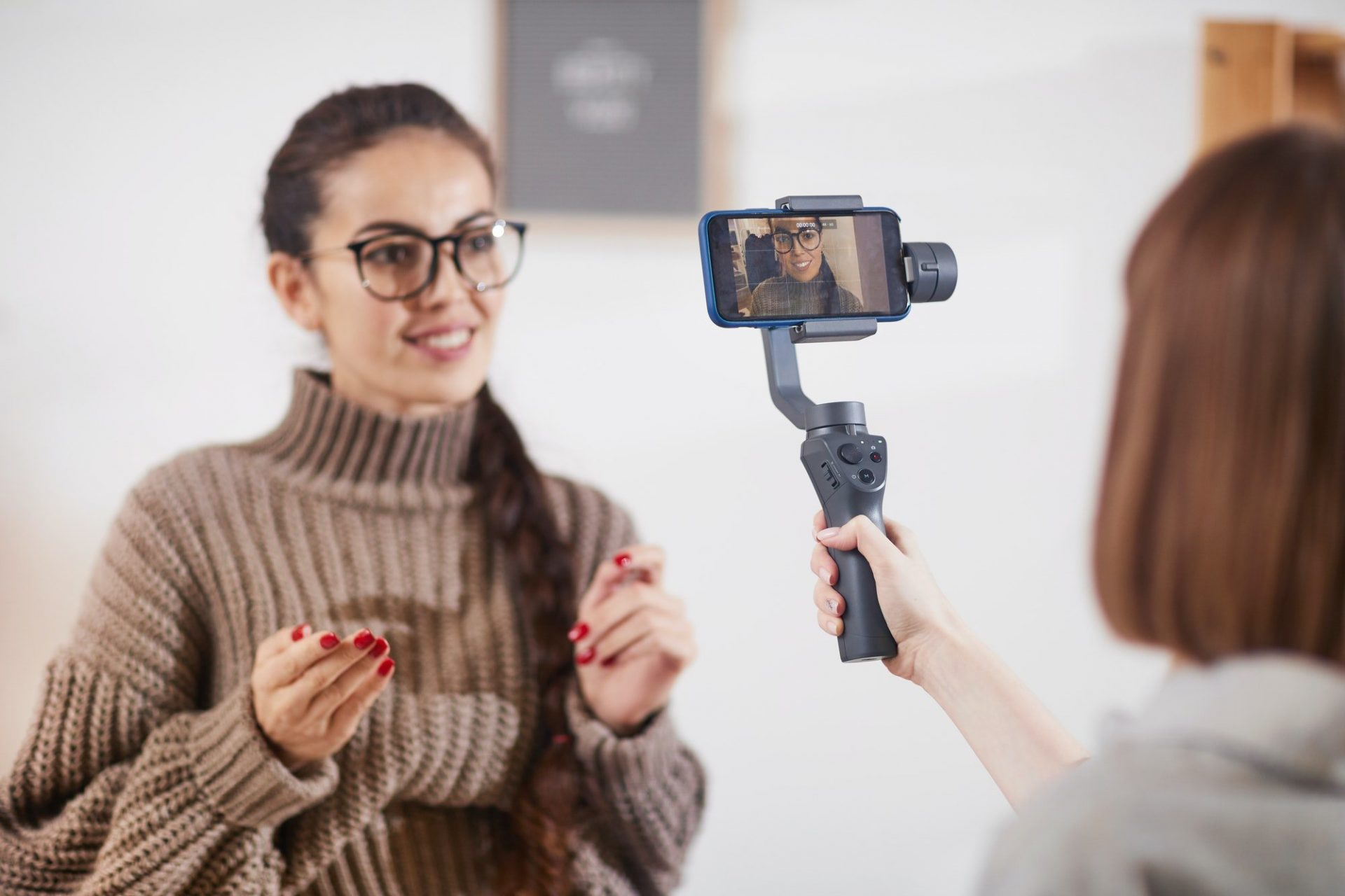 Smiling Woman Filming Video for Social Media Channel